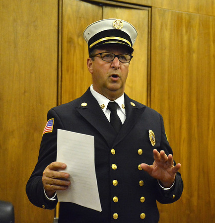 6/2/2015 Mike Orazzi | Staff Bristol Fire Chief  Jay Kolakoski during a pinning ceremony for new members Lawrence Rossi III and Marcin Kaczerski at city hall Tuesday evening.