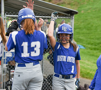 050117  Wesley Bunnell | Staff  Bristol Eastern defeated Bristol Central softball on Monday afternoon. Bristol Eastern's Taylor Keegan (1) high gives Erin Girard (13) after coming home to score.