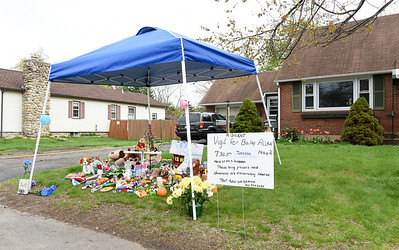 050117  Wesley Bunnell | Staff  A memorial has been set up in front of 79 Sycamore Street where a 21 month old toddler was accidentally struck by his father while moving a vehicle in the driveway.