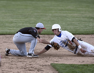 6/1/2017 Mike Orazzi | Staff Bristol Blues' Jake Frasca (27) tagged out at second by Josh Goulet (1) on opening night at Muzzy Field Thursday.