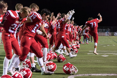 09/28/18  Wesley Bunnell | Staff  Berlin football defeated Plainville on Friday night at Sage Park. Berlin players line up facing the crowd to celebrate the victory including David Gagnon (51), Nick Melville (15), Rory Burns (72) and Michael Rivera (71).
