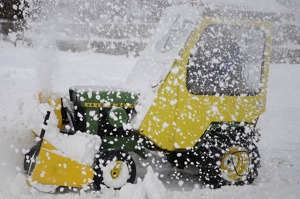 1/12/2011 Mike Orazzi | Staff Darryl LaPoint uses a 1974 John Deer tractor to clear snow from his driveway on Marion Avenue in Southington during Wednesday's snow storm.