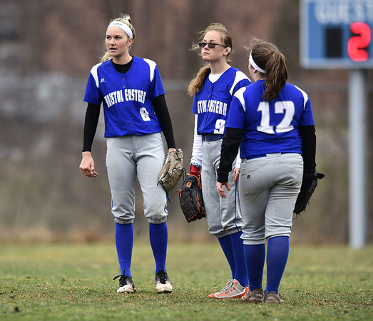 4/9/2019 Mike Orazzi | Staff Bristol Eastern's Zoe Lowe (8), Lyzah Corliss (9) and Riley Giblin (12) during Tuesday's softball game with Southington in Bristol.