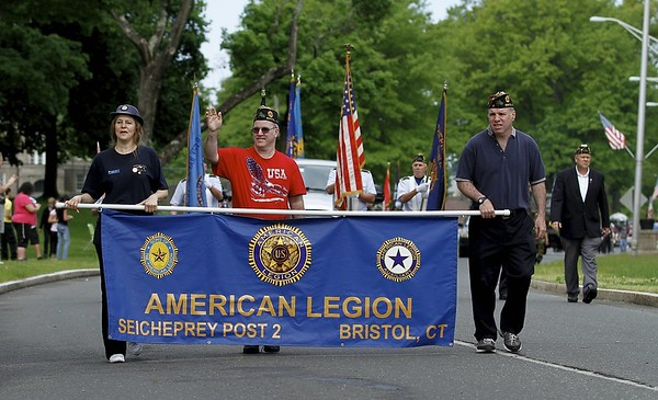 Kevin Bartram | Staff Members of American Legion Seicheprey Post 2 march as the Bristol Memorial Day parade moves along Memorial Boulevard Monday morning.