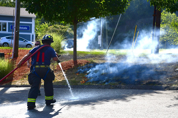 8/16/2019 Mike Orazzi | Staff Bristol firefighters extinguish a fire in grass along Broad Street after a reported transformer explosion on Friday afternoon.
