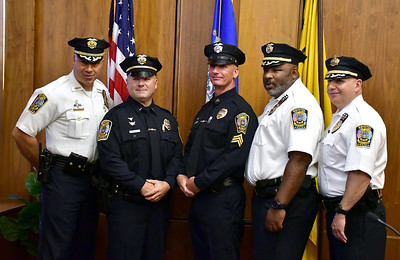 8/16/2019 Mike Orazzi | Staff Bristol Police Chief Brian Gould promotes  Lt. Lang Mussen and Sgt. Daniel Dwyer during a ceremony at Bristol City Hall on Friday morning with Captain Stephen Tavares and Captain Richard Guerrera.