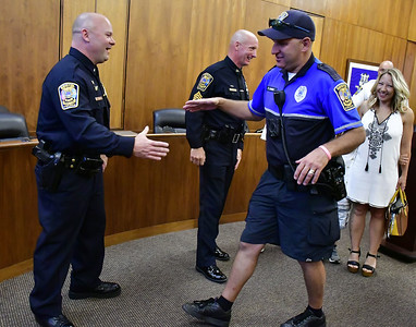 8/16/2019 Mike Orazzi | Staff Bristol Police Officer Peter Sassu congratulates Lt. Lang Mussen and Sgt. Daniel Dwyer after a promotion ceremony at Bristol City Hall on Friday morning.