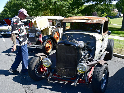 9/21/2019 Mike Orazzi | Staff Bill Ogo of Terryville looks over one the cars on display during Saturday's Mum Festival on Memorial Boulevard in Bristol.