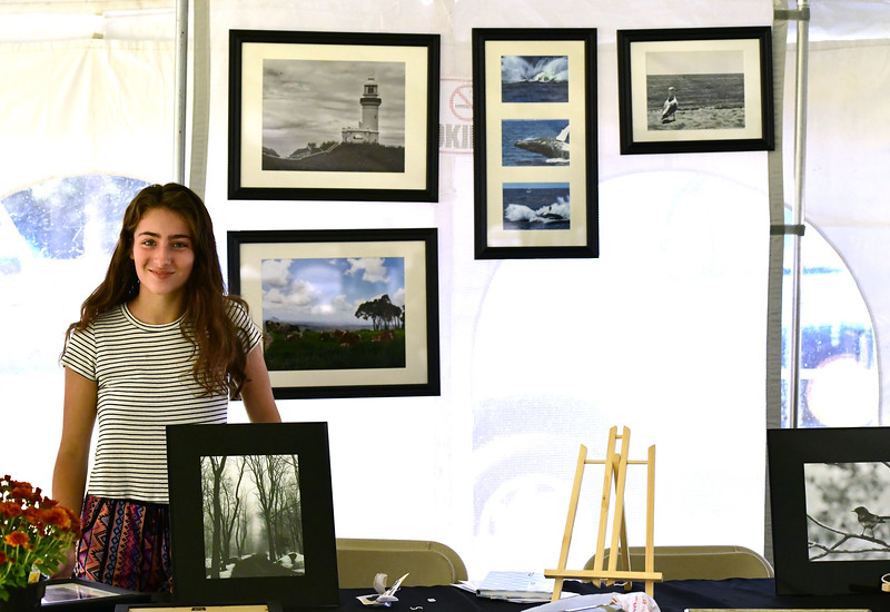 9/20/2019 Mike Orazzi | Staff Britni Pastrynak with some of her photography for sale during the Mum Festival on Friday evening in Bristol.