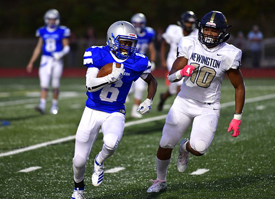 9/20/2019 Mike Orazzi | Staff Bristol Eastern's Treyvon Daniel (6) and Newington's Julian Mulero (10) during Friday night football in Bristol.