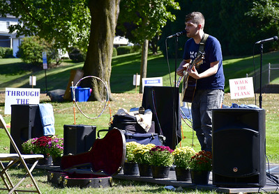 9/21/2019 Mike Orazzi | Staff Electric Shoe performs during Saturday's Mum Festival on Memorial Boulevard in Bristol.