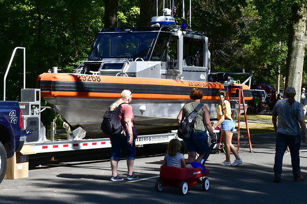 9/21/2019 Mike Orazzi | Staff A coast guard boat on display during Saturday's Mum Festival on Memorial Boulevard in Bristol.