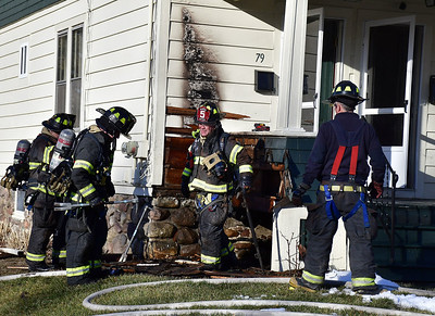 1/24/2020 Mike Orazzi | Staff Members of the Bristol Fire Department put out a fire on the exterior of a home on Grove Street in Bristol on Friday afternoon.  A passerby notified the home owner who began to put out the fire with an extinguisher before the fire department arrived.