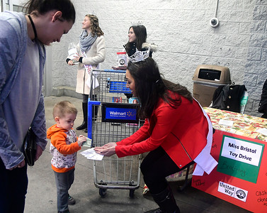 12/1/2016 Mike Orazzi   Staff Miss Bristol 2017 Gina Salvatore (center) with Miss Forestville's Outstanding Teen Cassandra Lechner (left) and Miss Bristol's Outstanding Teen Victoria Kilbourne (right) collects money from Jack Mendenhall during a toy drive outside the Bristol Walmart Thursday night.