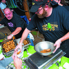 102416  Wesley Bunnell | Staff<br /> <br /> The Southington Chamber of Commerce's annual wing competition was held at the Cadillac Ranch on Monday evening.  Cooks from the Groggy Frogg serve up hungry customers.