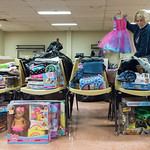 121416  Wesley Bunnell | Staff  The Town of Plymouth Human Services along with the Plymouth Police Department held their annual toy drive. Jackie Merchant holds up princess dresses as she he ...