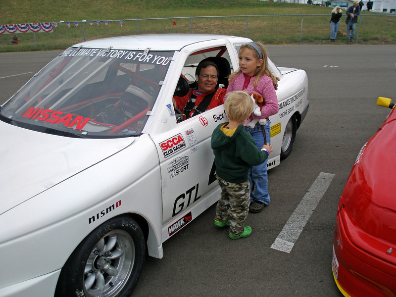 """Emmie and Zane wishing """"Pucky"""" good luck on the false grid for the start of the 2007 SCCA National Championship Runoffs.<br /> <br /> <br /> 'OLYMPUS DIGITAL CAMERA"""