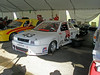 Inside the Nissan Tent at the 2007 Runoffs. That's Bill Partridges car (very quick)on the left.