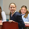 "Sydney Wagner, front with Caitlin Mc Farlane, left, and Ally Kay Dean answer questions during 7th grade literature class studying the book ""The Devil's Arithmetic"" at the Broomfield Academy on Thursday.<br /> January 10, 2013<br /> staff photo/ David R. Jennings"