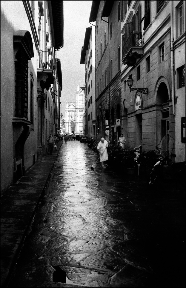 I remember the moment; the rain had stopped and Santa Corce was lit up at the end of the lane and this guy in white was sweeping. Grabbed the shot. Ten years later here it is!
