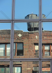 Cistern reflecting in a window on Houston St.