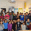 Mrs. Baldwins 5th grade class with light bulb displays.