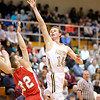 Don Knight / The Herald Bulletin<br /> Lapel's Mitchell Richardson shoots over Frankton's Nick Wright during the Madison County Boys Basketball Tournament at Pendleton Heights on Saturday.