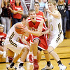 Don Knight / The Herald Bulletin<br /> Frankton's Aaron Korn drives past Lapel's Noah Hendershot and Bailey Partington during the Madison County Boys Basketball Tournament at Pendleton Heights on Saturday.