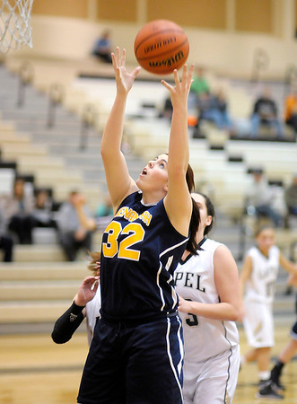 Don Knight / The Herald Bulletin<br /> Sheanandoah's Rachel Krathwohl grabs a rebound as Lapel hosted Shenandoah on Saturday.