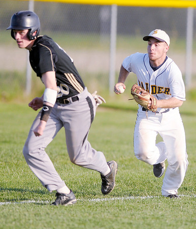 Shenandoah's Chandler Grogan chases down Lapel's Nolan Clark as the Raiders hosted Lapel on Wednesday.