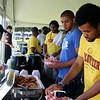 Volunteers fuel up at AAMU tent.