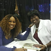 First Lady Abbiegail Hugine (r) shares a special moment with award-winning Gospel legend Yolanda Adams during the Tom Joyner Family Reunion Weekend Celebration in Orlando, Fla.  The President and First Lady also participated in concurrent events affiliated with the MEAC-SWAC Football Challenge.