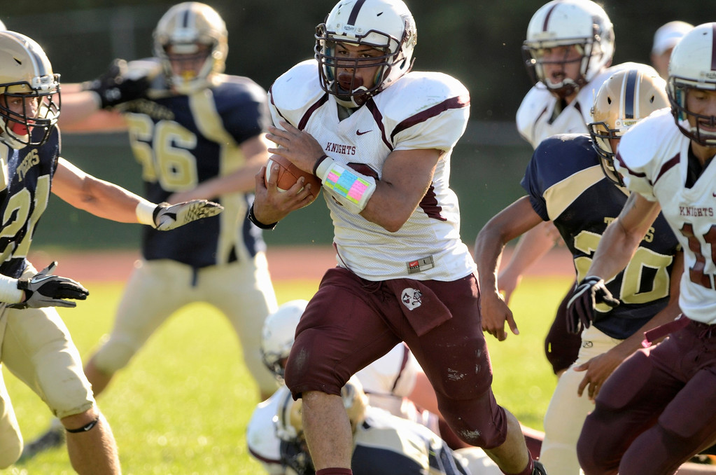 . Mike McMahon - The Record,  Lansingburgh Knights Josh Rodriguez makes big yardage for Lansingburgh\'s first Touchdown in the first Quarter at Cohoes Tigers High School football Friday, September 20, 2013.