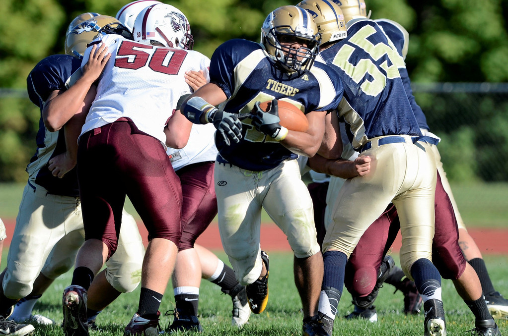 . Mike McMahon - The Record, Cohoes Josh Malulan finds a big hole for big yardage in the first quarter vs the Lansingburgh Knights at Cohoes Tigers High School football Friday, September 20, 2013.