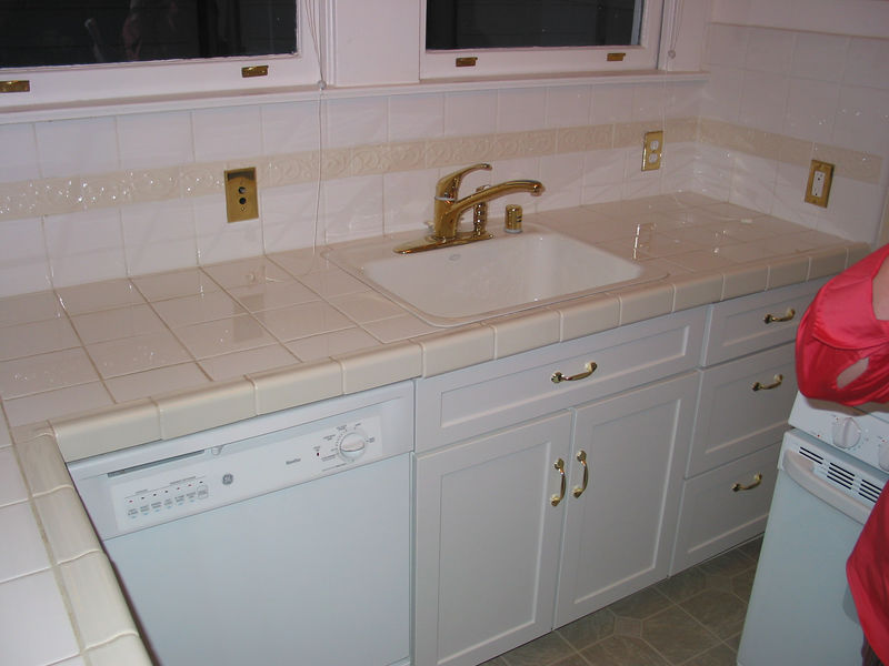 Kitchen: dishwasher,  sink, cabinets, oven