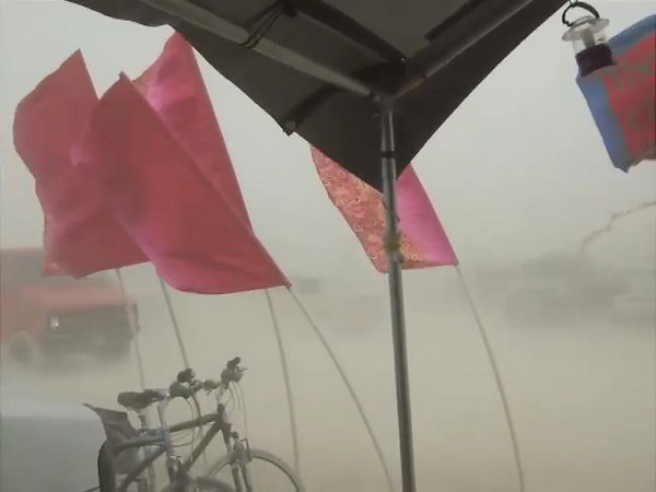 One of the several dust storms to blow through. I would not take my camera out (this is from the Fujifilm F30) when the storm was at its worst - you could not see across the street to that other flag when the dust was at its height.
