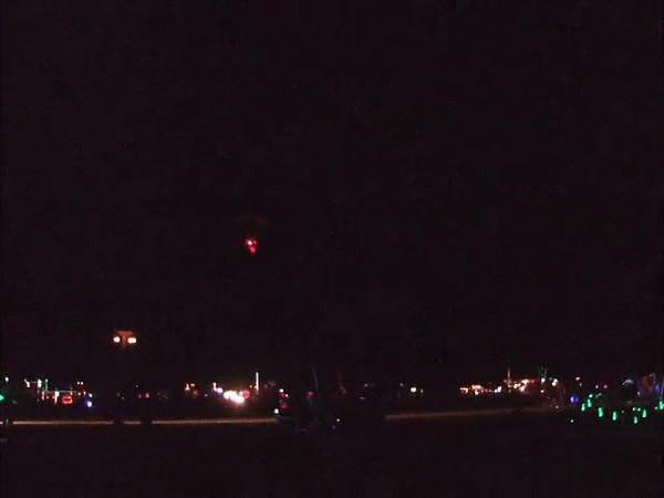 A night time parachute drop.