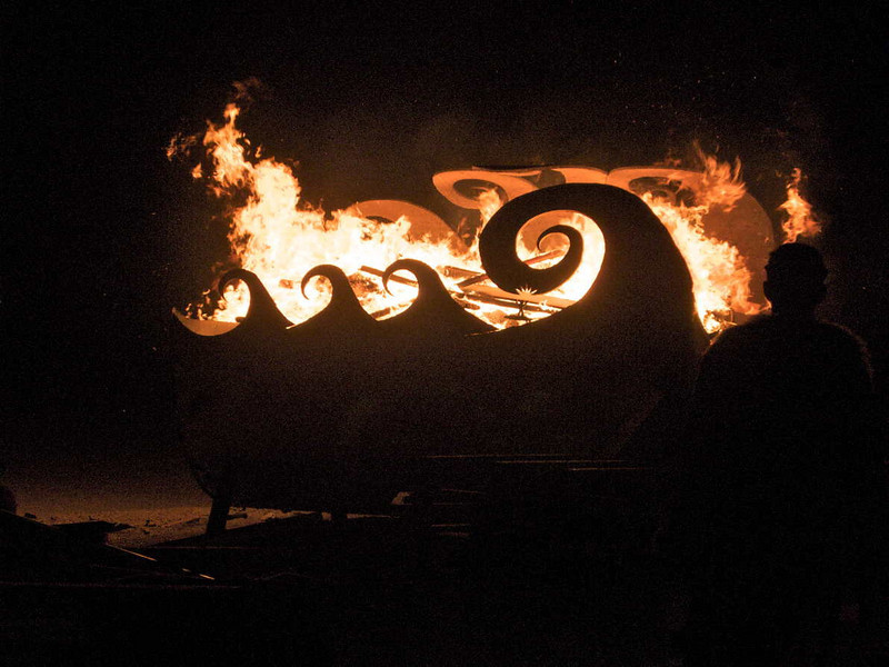 The burn barrell at 7:00 o'clock.