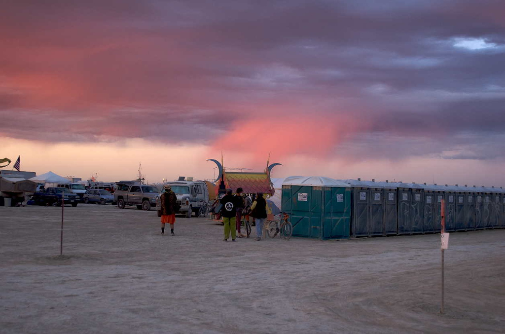 That's actually rain in that pink cloud hanging down behind the portapotties. Often it doesn't reach the playa, but on Sunday night it sprinkled during a dust storm after the Temple Burn.