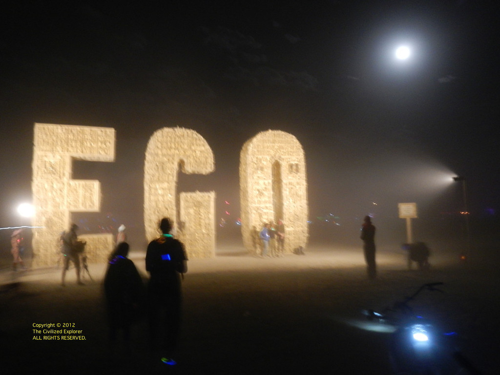 EGO by Laura Kimpton And Michael Garlington. The piece is constructed of wood with 10,000 gold replicas of trophies.