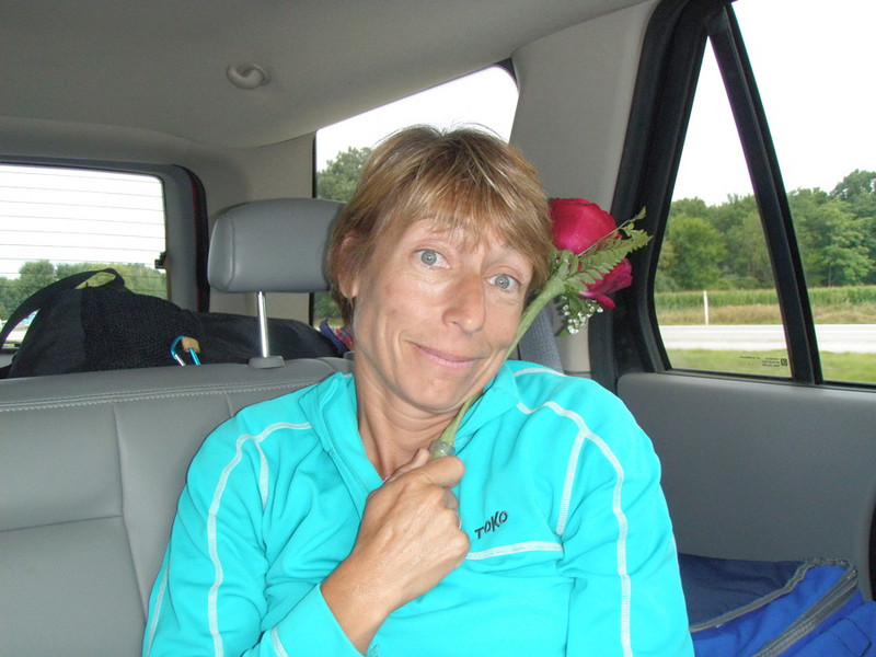 "Stephanie Astell in the back of our car with the rose from her ""Mexican birthday"" celebrated the night before."