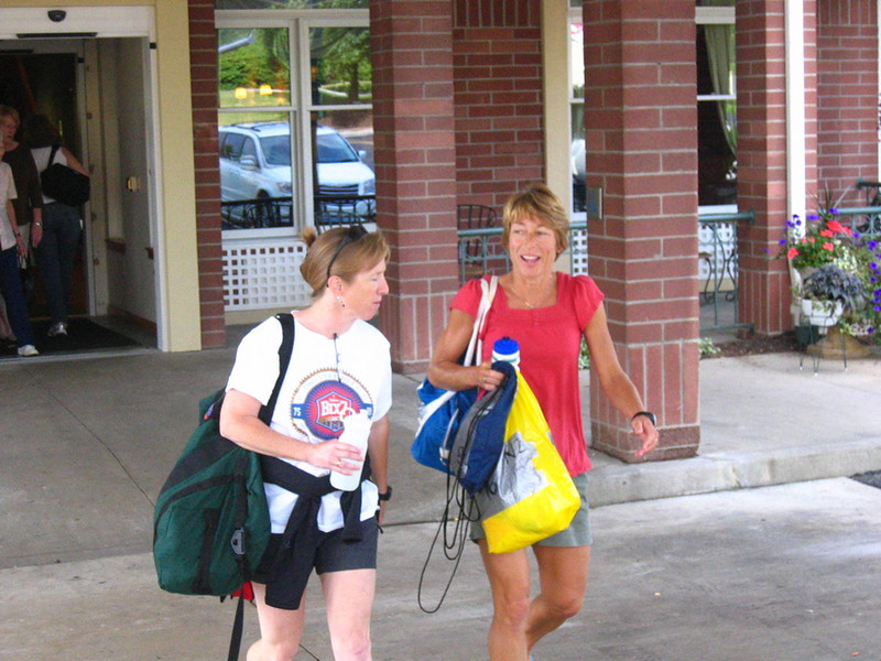 Mary and Stephanie head to packet pick-up with drop bags in hand.