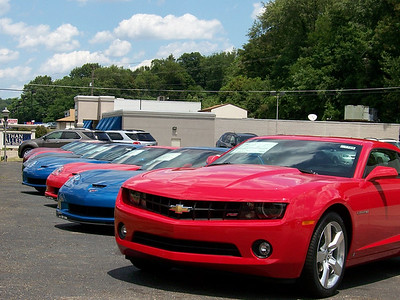 A pack of Corvettes and a 2010 RS Camero, leading the way.