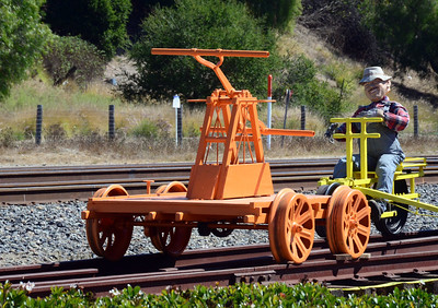 A handcar and velocipede at the SLO Freight House.