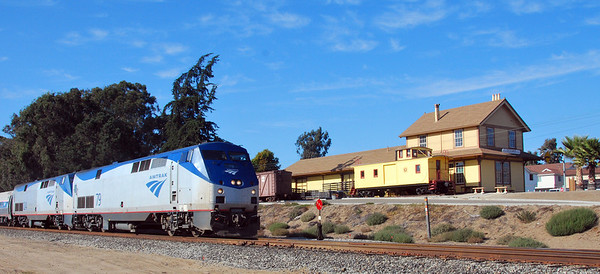 The southbuond Amtrak Coast Starlight passes the Oceano Depot.
