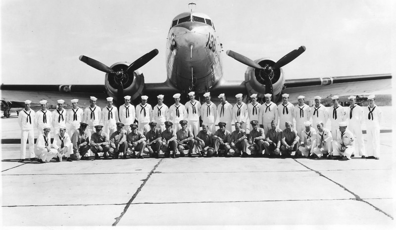 1954 - CDR William A. Prescott was CO of VR-712, US Navy Transport Squadron - NAS Denver / Buckley Field.  CDR Prescott is in the front row, center - ninth from the left facing the photo.
