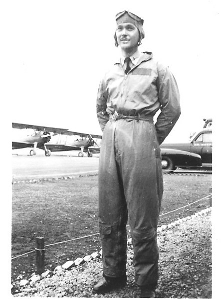 1943 - Lt. William A. Prescott standing in front of a row of N2S Stearmans that he instructed in at NAS Anacostia, Washington, DC