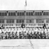 1954 - CDR William A. Prescott was CO of VR-712, US Navy Transport Squadron - NAS Denver / Buckley Field.  CDR Prescott is in the front row, center - eighth from the left facing the photo.