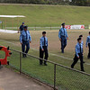 The troop from the Manly squadron  of the Australian Air League leads of the procession followed by the main planes of the Taylor Glider at Rat Park, North Narrabeen on 5th December 2009 to mark the centenary of the first man-carrying, heavier-than-air flight in Australia.