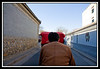 View from pedicab as driver pedals through hutong...
